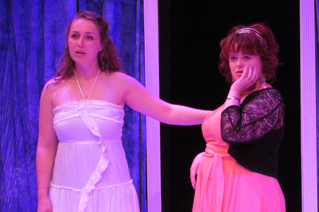 Cassie Fastabend '15 (left), a graduate of Puget Sound's theatre arts program, was the title character in New Muses Theater's production of Lysistrata. The show ran at Tacoma's Dukesbay Theater in June and July. Photo by New Muses Theater.