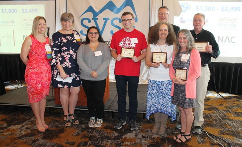 The Snoqualmie Valley Schools Foundation honored the Snoqualmie Valley School District's 2019 Educators of the Year at its annual luncheon in May. From left: schools foundation board member Sheri Absher; schools foundation president Lorraine Thurston; Mount Si High School AVID students Elena Lopez and Richard Anderson, who accepted the 2019 Educator of the Year award on behalf of their teacher Marcella Murphy; Snoqualmie Valley School District superintendent Rob Manahan (back); Anne Barnard Melgaard '90; Twin Falls Middle School science teacher and 2019 Middle School Educator of the Year Dawn Frearson; and elementary school custodian and Classified Educator of the Year Robert Lacher.