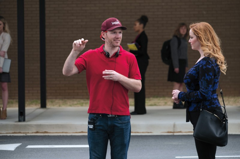 Complete with a Puget Sound cap, Ben Shelton '03 directs actors on the set of the Netflix original film Candy Jar.