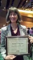 Alumni Lynn Swedberg receiving her FAOTA