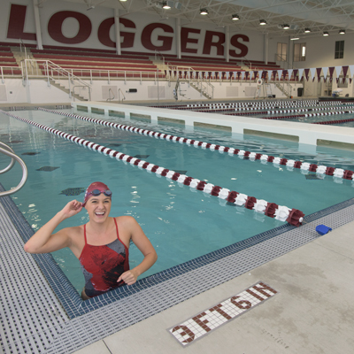 Kayla Dimicco '18, a psychology and business major from Kirkland, Washington and a member of the women's swim team, warms up before practice.