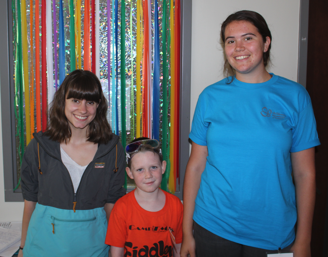 Linnea Stoll '20 (left) and Meadbh Koenigsbergh '20 (far right) with a Children's Museum of Tacoma summer camper