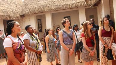 People looking at Traditional Ashanti homes in Kumasi