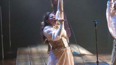 Actors singing on stage