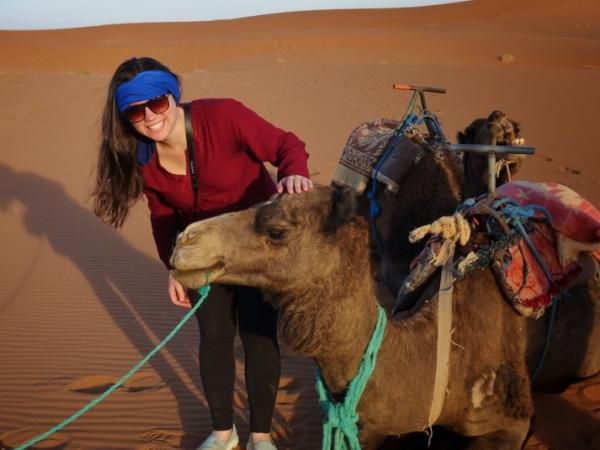 Amanda Klein with a camel in the Middle East