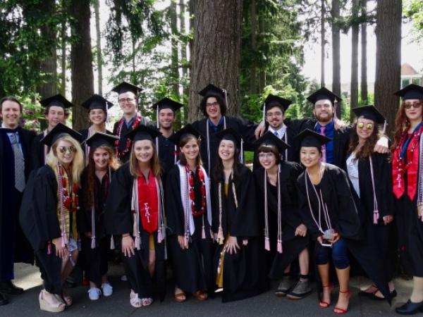 Graduate students wearing caps and gowns